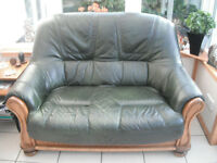 Two seeter leather sofa for sale green leathert