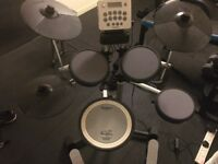 Roland V-Drums HD-3, stool, books, sticks, practice pad