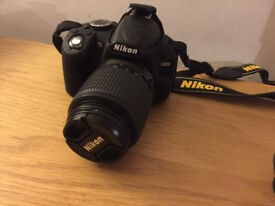 Nikon D3100 DSLR with two lenses, battery and case