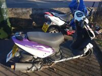 Two mopeds spair or repaire