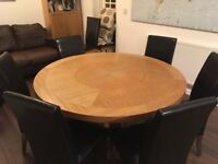 Light oak veneer round dining table with built in lazy Susan