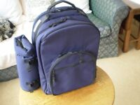 Picnic Rucksack for 4 persons with attached bottle carrier.