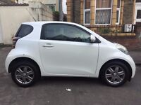 2009 IQ. Great city car, reliable and economical.