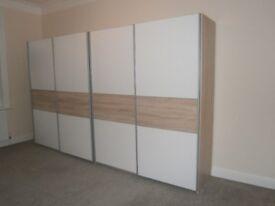 Two double door wardrobes with sliding doors