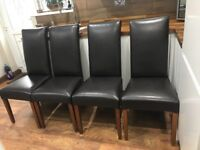 Set of four chocolate brown leather look dining chairs