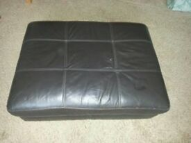 BROWN LEATHER FOOTSTOOL WITH STORAGE.