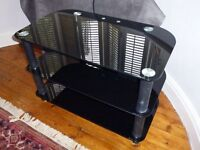 Black glass TV stand heavy & solid