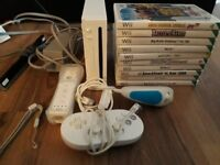 Wii with remote, nunchuck, controller and 10 Games - £30