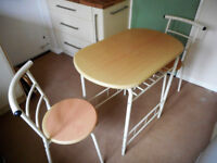 Breakfast bar table and two chairs.