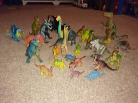Mixture of 25 dinosaurs and dragons