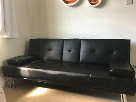 Black Faux leather sofa bed with fold down arm rest and cup holder