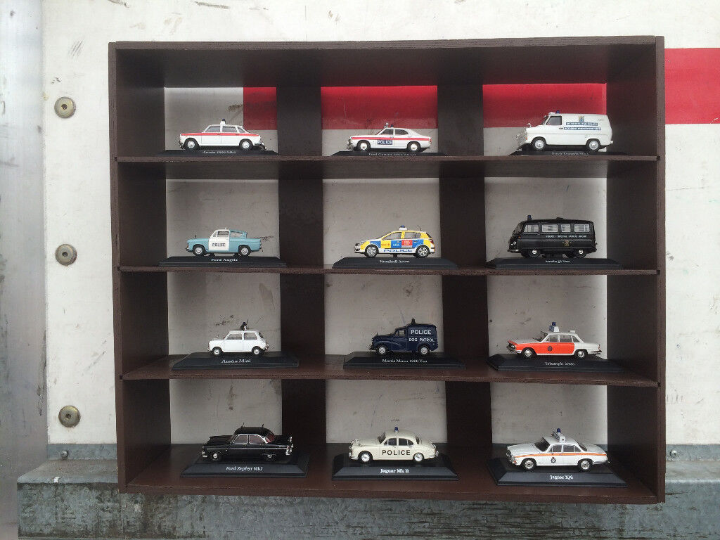 POLICE CAR AND VAN COLLECTION STILL BOXED IN A CABINET
