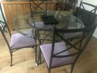 Glass dining table and 4 chairs with graphite iron frame