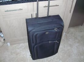 large tripp pull along suitcase