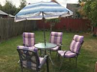 Gardens chairs, table and umbrella