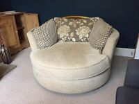 2 Seater swivel chair/sofa. DFS cream. Good condition.