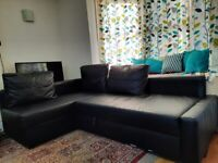 ikea corner sofa black leather with storage underneath. can be used as sofa bed
