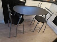 Two seater dining table with 2 chairs