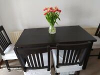 Dining table with 4 chair and different colour seat covers