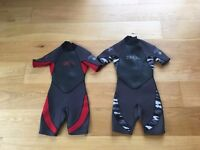 Two children's Xcel wetsuits size 8 and 10 in excellent condition