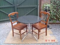 Granite Topped Bistro Table with Two Wooden Chairs. Can Deliver.
