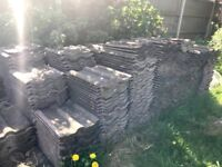 Roughly 1000-1200 roof tiles available