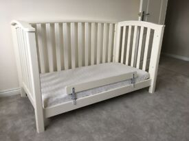 Suitable from birth until age 4. Includes mattress.