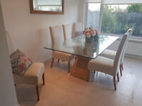 Large glass table and fabric dining chairs