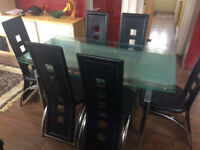 EXTENDABLE GLASS TOP DINING TABLE AND 6 HIGHBACK CHAIRS
