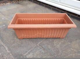 Plastic outdoor planter