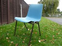 Plastic stacking chairs, cheap and in moderate condition.