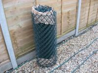 "roll of chainlink fencing 15/m long aprox 36"" high never used, new green pastic covered £25"