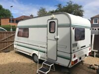 2 berth caravan with full awning. Can deliver.