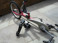 Wheelchair cycling attachment
