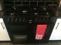 Black range cooker and matching hood