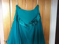 Stunning dark green below knee dress and Red or dead shoes. Dress Size 20 Shoes size 8