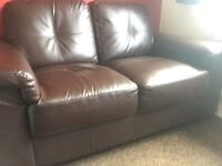 Brown faux leather sofa good condition