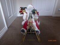 Santa On Metal Sleigh
