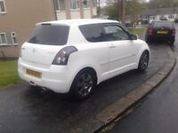 2008 suzuki swift,white,1300cc,very smart car,tinted glass,alloys,m.o.td and taxed,spares repair£700