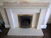 Cream marble fireplace, surround, hearth, and gas fire