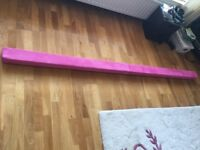 Gymnastics Beam. Rarely used and in perfect condition. Brand is slim gym and colour is pink.