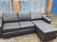 Very nice Brand New Black leather corner sofa. or use as 3 seater and puff. can deliver