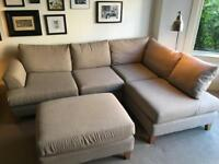 Large beige corner sofa with footstool