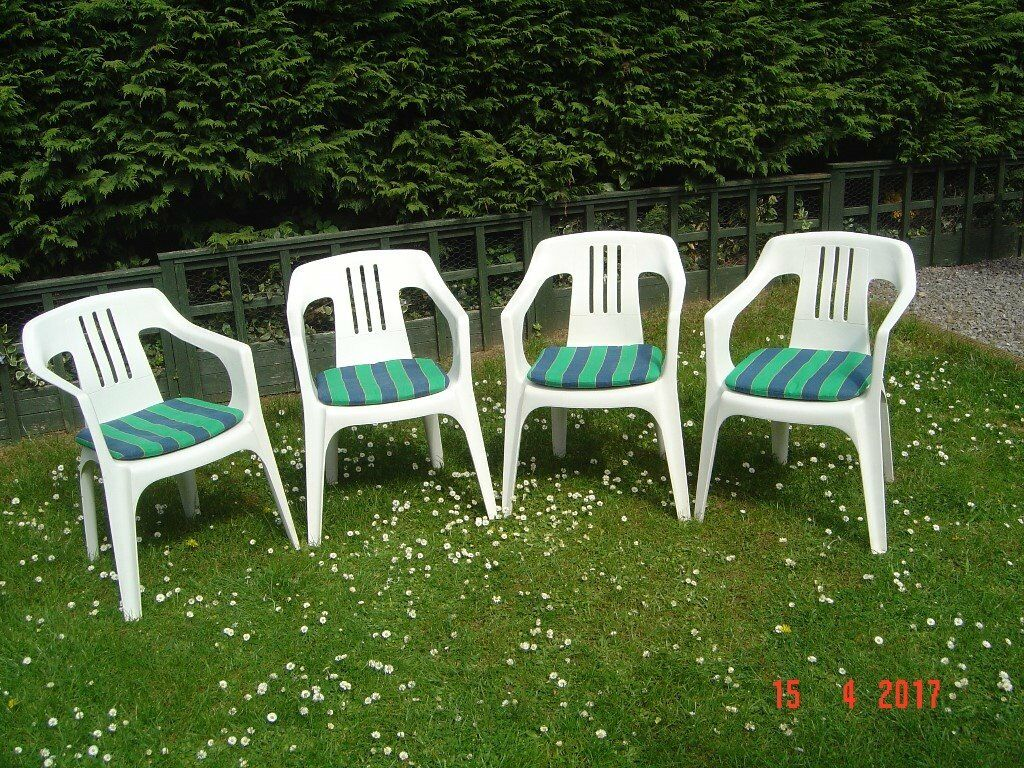 four plastic patio chairs with cushions can deliver - Garden Furniture Yate