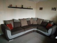 Right hand corner sofa in brown with matching curtains from Dunelm