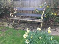 Wrought iron and wood antique garden bench