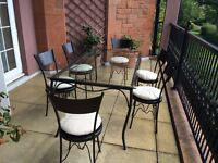 Magnificent Metal and Glass-Topped Table and 6 Chairs With Cushions