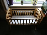 Wooden baby crib and bedding