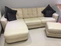 Cream leather sofa bed and puffet