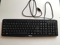 Black Trust classic line wired keyboard.